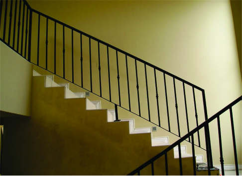 Metal indoor modern interior staircase with hand railing manufactured and installed by Twisted Steel, Port Elizabeth