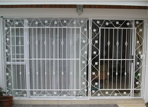 Security cage, white floral pattern in front of sliding door