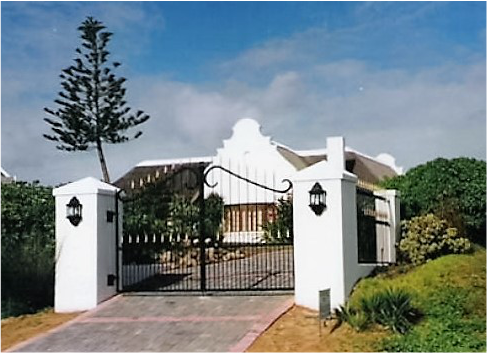 Dutch style house with elegant swinging gate by twisted steel