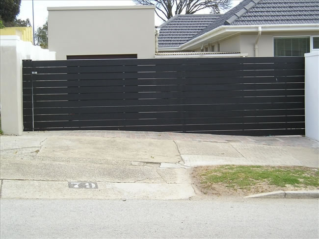 Horizontal Sliding Driveway Wooden Gate with auto sliding. Wooden Gates manufactured by Twisted Steel, Port Elizabeth.